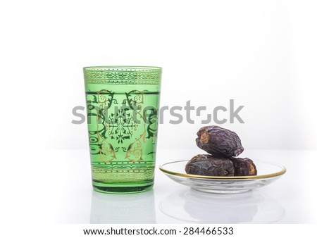Glass of drinking water and date fruits are usually consumed before breaking fast during holy month of Ramadan- The Muslim Lent - stock photo