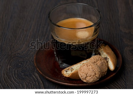 glass of espresso, biscotti and almond cookies, close-up - stock photo