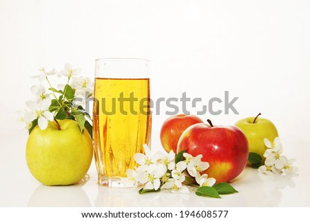 Glass of fresh apple juice with ripe apples - stock photo