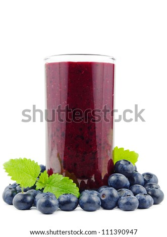 Glass of fresh blueberry smoothie with blueberries on white - stock photo