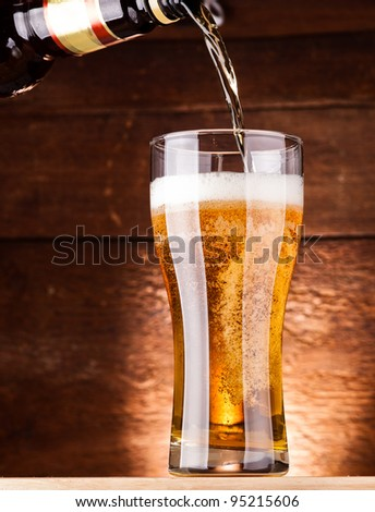 glass of fresh golden beer - stock photo
