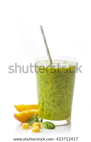 Glass of fresh healthy fruit and spinach smoothie isolated on white background - stock photo
