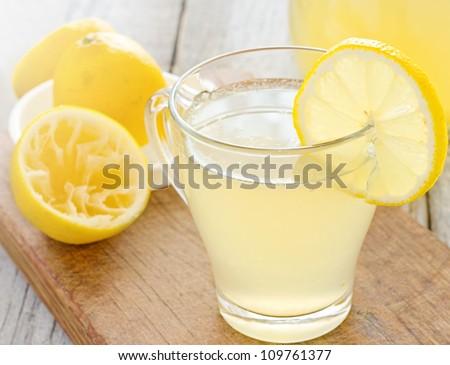 Glass of fresh homemade tasty lemonade - stock photo
