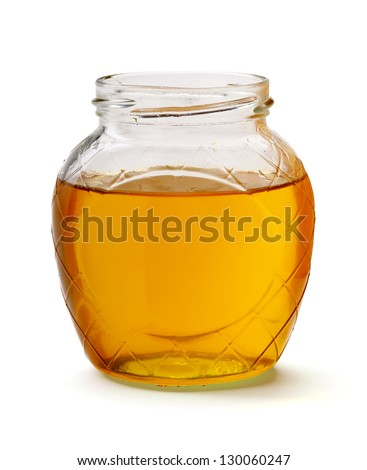 glass of fresh honey isolated on white background - stock photo