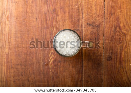 glass of fresh lager beer on wooden table. - stock photo
