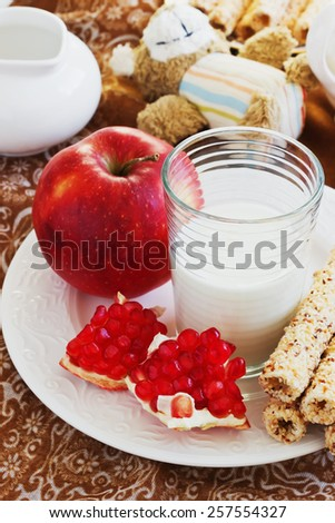 glass of fresh milk, cookies and ripe fruit on the table. healthy breakfast.selective focus - stock photo