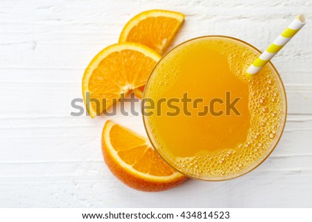 Glass of fresh orange juice from top view - stock photo