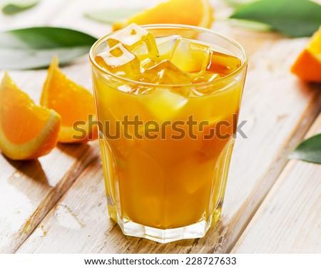 Glass of fresh Orange juice  . Selective focus - stock photo
