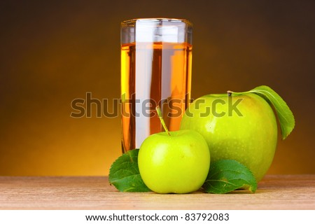 Glass of healthy fresh juice of apples on brown background - stock photo