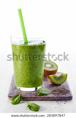 Glass of healthy green vegetable and fruit smoothie - stock photo