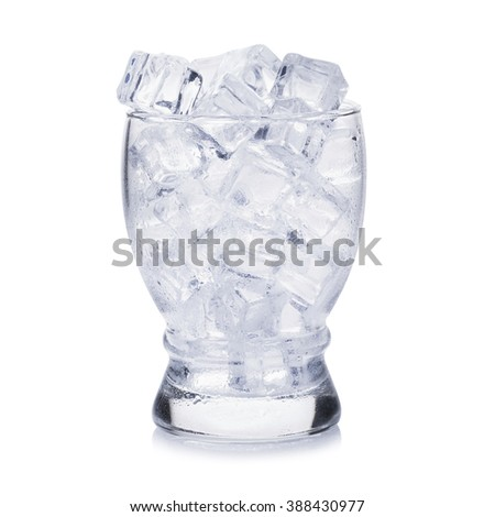 Glass of ice cubes on white background. - stock photo