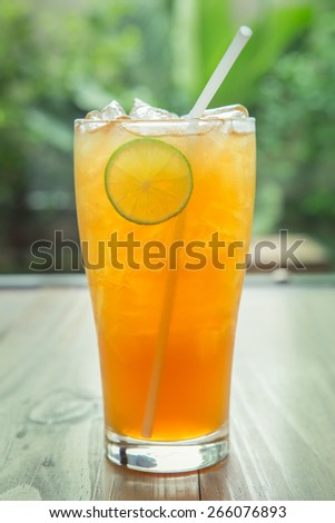 glass of ice tea with lemon - stock photo
