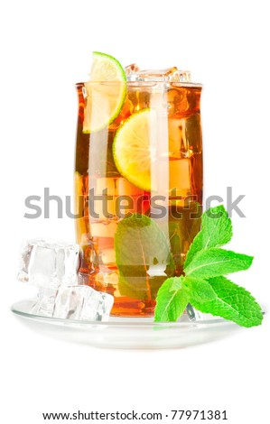Glass of iced tea with ice cubes, lime and mint on white background - stock photo