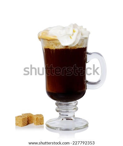 glass of Irish coffee and sugar cane on a white background. - stock photo