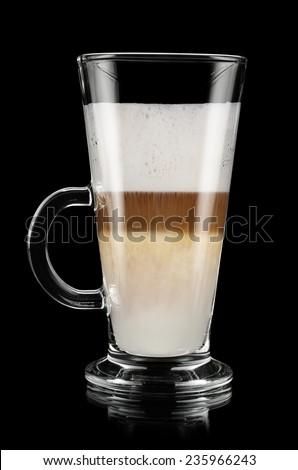 Glass of latte macchiato over black background - stock photo