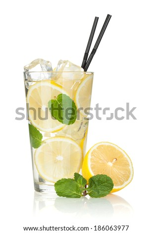 Glass of lemonade with lemon and mint. Isolated on white background - stock photo