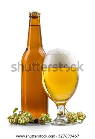 Glass of light beer and bottle with hops - stock photo