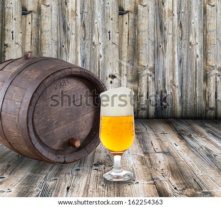 Glass of light beer on a table - stock photo