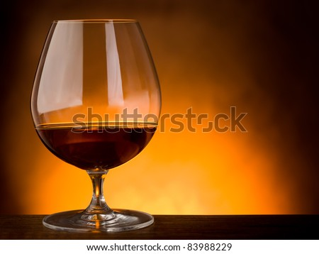 glass  of liquor on wood table with copy space - stock photo