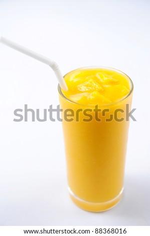 Glass of mango juice shot against white background - stock photo