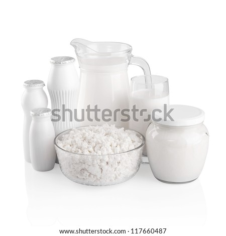 Glass of milk and carafe on white background - stock photo