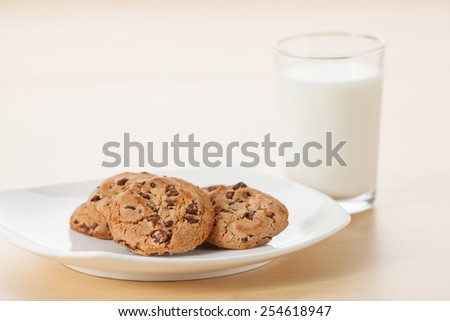 Glass of Milk and Chocolate Chip Cookies - stock photo
