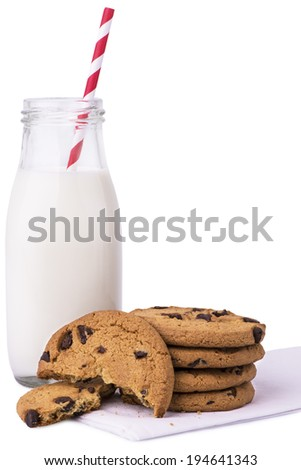 Glass of milk and cookies, isolated on white background. - stock photo