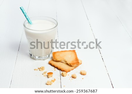 Glass of milk and shortcake cookie with copyspace - stock photo