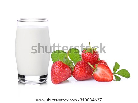 glass of milk and strawberry on white background - stock photo