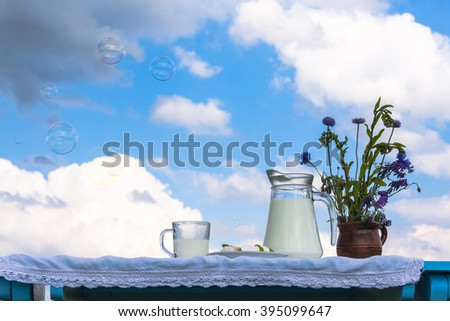 Glass of milk and sunny day. - stock photo