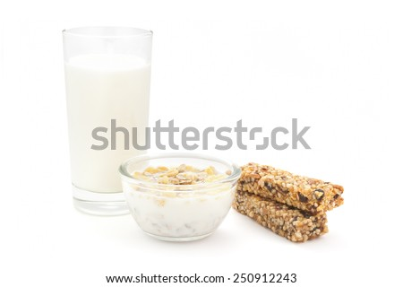 Glass of milk, corn flakes and cereal bars �¢?? healthy breakfast - stock photo