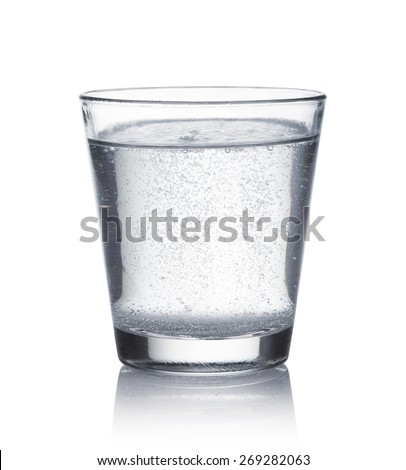 glass of mineral water on white background - stock photo