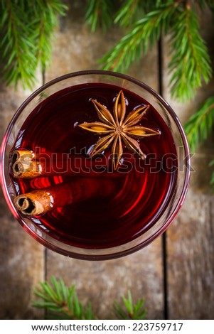Glass of mulled wine with cinnamon and anise, top view - stock photo
