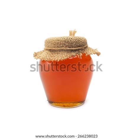 glass of nature honey isolated on white background - stock photo