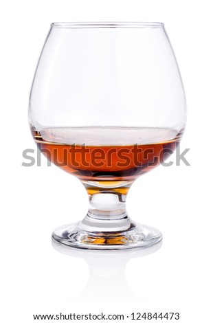 Glass of or brandy isolated on white background - stock photo