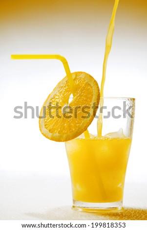 Glass of orange juice - stock photo