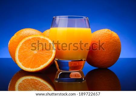 glass of Orange juice and oranges - stock photo