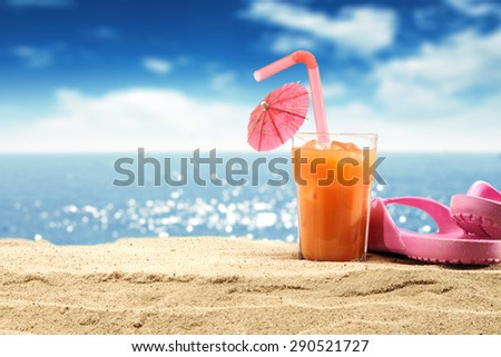 glass of orange juice and pink shoes  - stock photo