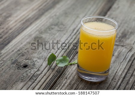Glass of orange juice the wooden board - stock photo
