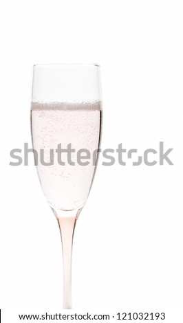 Glass of pale pink champagne on white background - stock photo
