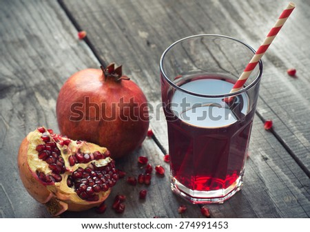 glass of pomegranate juice with fresh fruits - stock photo