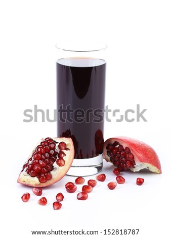 Glass of pomegranate juice with sliced fruits - stock photo