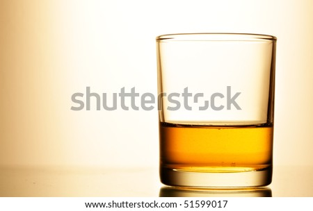 Glass of pure whisky close up - stock photo