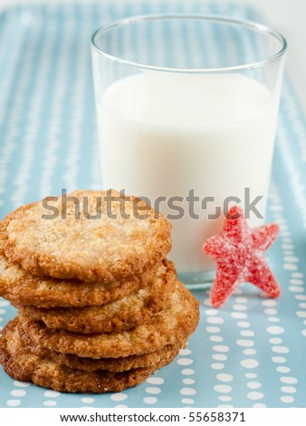 Glass of Raw Milk and Short Stack of Oatmeal Cookies - stock photo