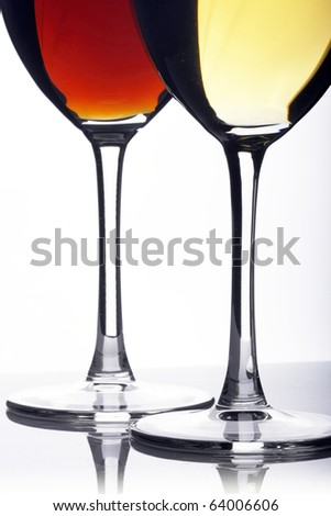 Glass of red and white wine on a white background and with soft shadow - stock photo
