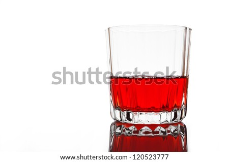 Glass of red juice on white - stock photo