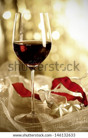 Glass of Red Wine and Christmas Ornaments, selective focus - stock photo