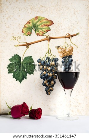 glass of red wine background grape cluster decorated, romantic moment with red rose , natural light, vertical photo - stock photo