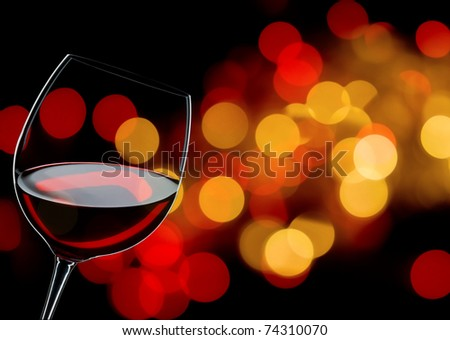 glass of red wine close up, background lights - stock photo