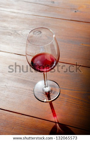 glass of red wine on a light background - stock photo